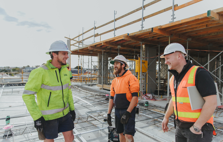 Workers laughing together