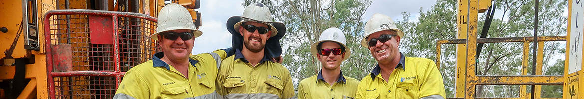 Four Mitchell Services drillers in high-vis safety gear