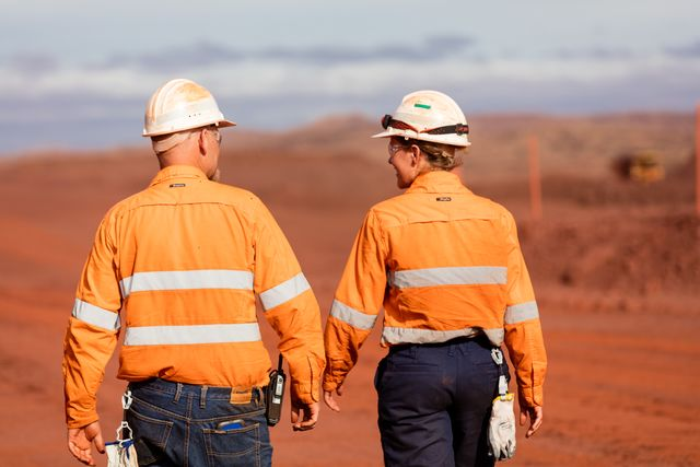 Two BHP mine workers walking away